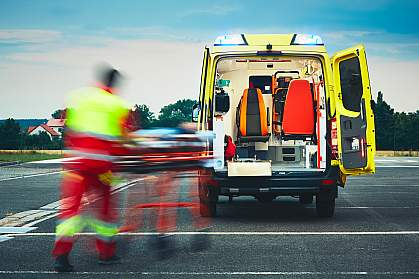 Emergency medical service team rushing someone to an ambulance