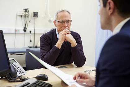 Doctor discussing test results with concerned patient