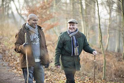 Two older men on a winter walk.