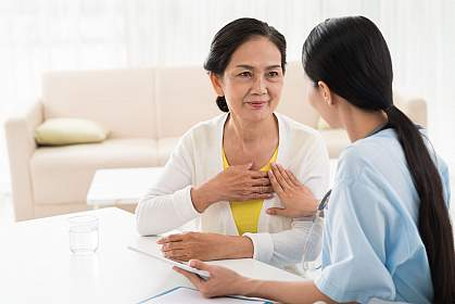 Older woman and doctor discussing heart diseases