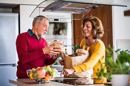 Senior couple preparing healthy food