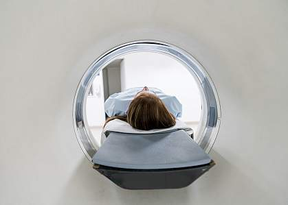 Female patient lying down for an MRI exam