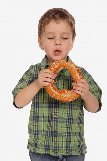 Boy with large sesame seed bagel