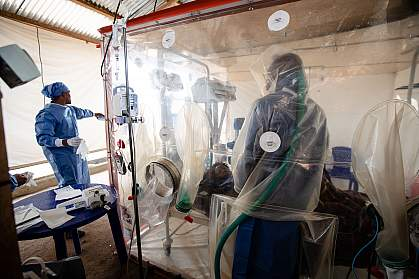 Health workers caring for a patient suspected of having Ebola