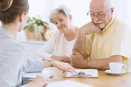 Senior couple making a decision with an advisor