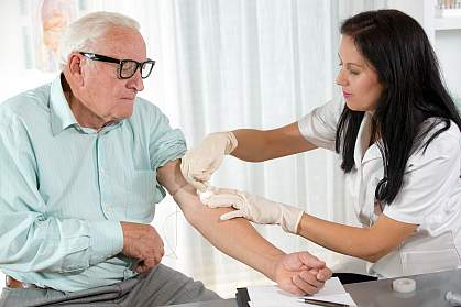 Older man getting blood drawn