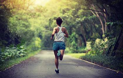 Woman running on a park trail