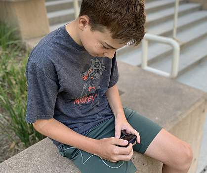 Study participant reviews information on his artificial pancreas device.