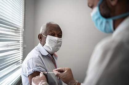 Mature black man getting vaccination