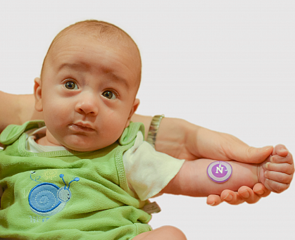 Baby with sweat sticker on arm