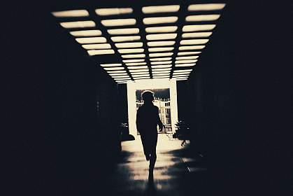Person in shadow running through creepy underpass