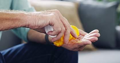 Shot of an unrecognisable senior man taking medication at home