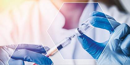 Filling a syringe with a vaccine