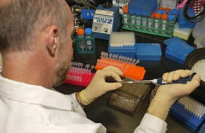 A scientist preparing DNA for analysis.
