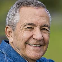 Close-up of a senior man smiling.