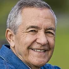 Close-up of a senior man smiling.