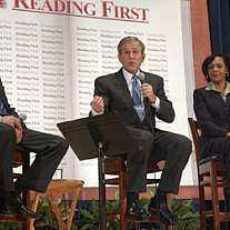 President George W. Bush speaks into a microphone