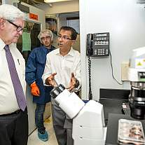 Former Speaker of the U.S. House of Representatives Newt Gingrich tours Dr. Kapil Bharti's lab at the National Institutes of Health
