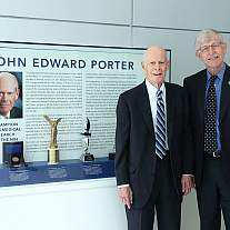 Congressman John Edward Porter (left) and NIH Director Dr. Francis Collins pose next to an exhibit honoring the Congressman's strong leadership on behalf of NIH research.