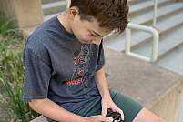 A boy checking his sugar.