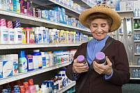 Image of a woman looking at bottles of vitamins.