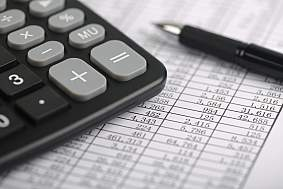 Save Calculator And Pen On Sheet - stock photo