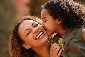 Mother and daughter laughing together.