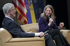Francis Collins and Sylvia Burwell share light moments on stage during a town hall meeting.