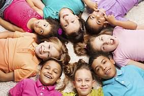 Diverse kids in a circle.