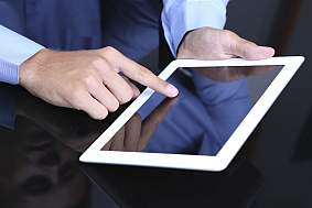 A person using a tablet.