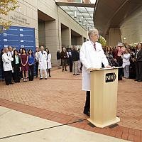 Francis Collins in front of the Clinical Center.