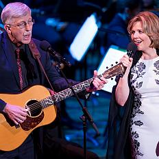NIH Director Dr. Francis Collins and renowned soprano Renée Fleming perform on stage at the Kennedy Center for Sound Health's Music and the Mind.