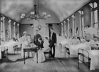 Dr. Joseph Goldberger seated at a table in a hospital.