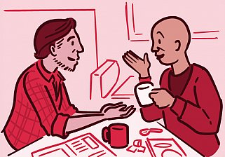 Two men at a table engaged in conversation over a cup of coffee