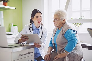 older adult with doctor