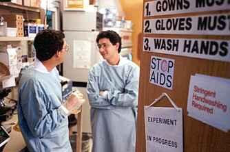Researchers talking in a lab.