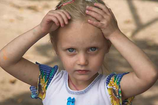 Little girl with a serious expression on her face.