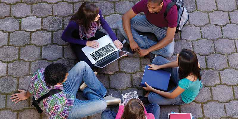 A group of students with laptops.