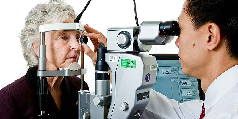 A woman receiving an eye exam from a ophthalmologist.