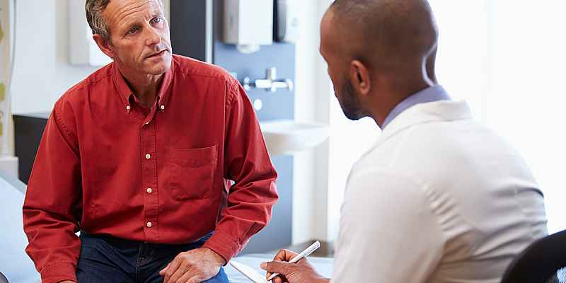 A man talking with a doctor.