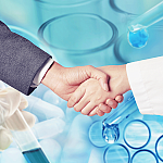 Close-up of a business man shaking hands with a female researcher.