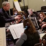 Braunstein conducts the Me2 Orchestra.
