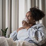 Mature woman using an inhalation mask at home