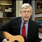 Dr. Collins playing his guitar.