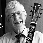 Dr. Collins with guitar