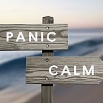 Panic and calm signs pointing in different directions