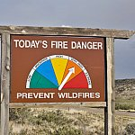 Fire danger roadside sign with arrow pointed to very high