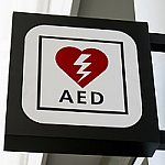 A sign with a heart and thunderbolt that says AED, which means Automated External Defibrillator