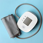 A blood pressure monitor on a blue background