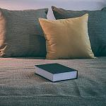 A book sitting on a bed